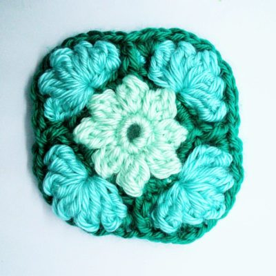 Ice flower granny square - free crochet pattern by Crochet Cloudberry. This pattern uses simple stitches to create raised petals and leaves.